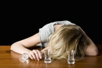 A Young Woman Passed Out Drunk on a Bar Counter --- Image by © Patrick Strattner/fstop/Corbis - Республика Татарстан